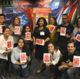 image of group holding the print art they made