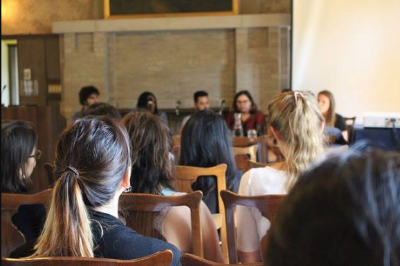 image of a panel and the audience