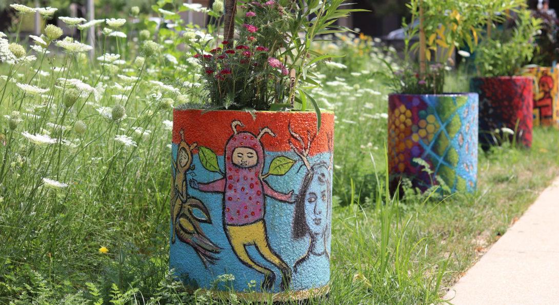 Pollinator urns in garden