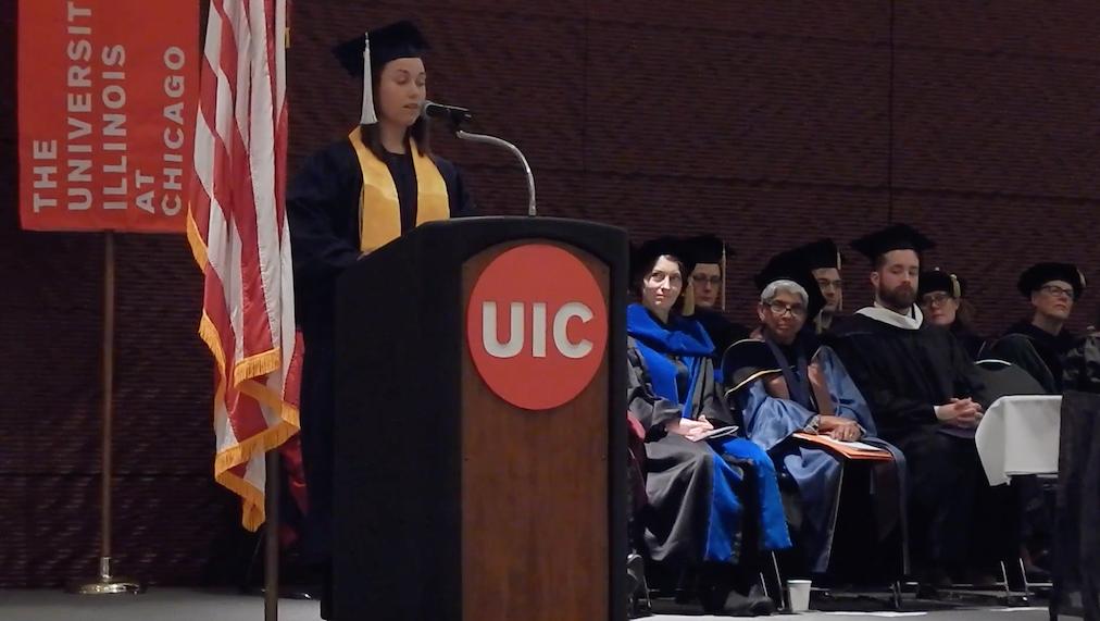 Lucia Whalen giving commencement speech