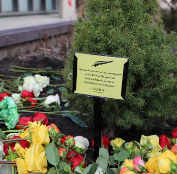 Heritage Garden tree with flowers in commemoration
