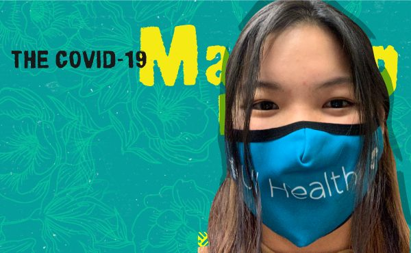 Janna wearing a light blue mask with the UI Health logo